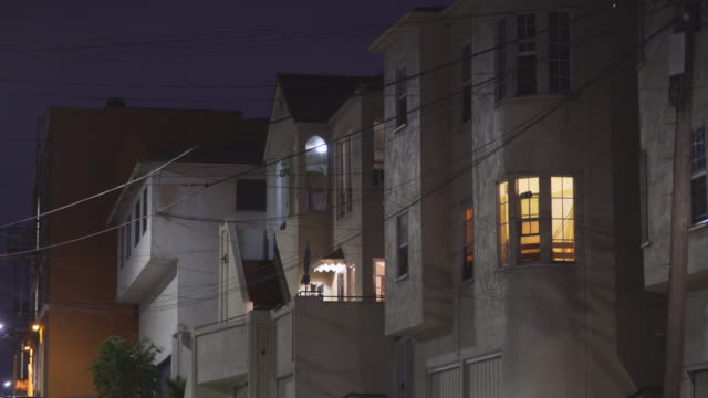row of apartments in east los angeles - night - flat stock videos & royalty-free footage