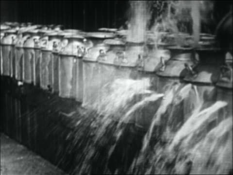 b/w 1934 row of beer kegs being shot + beer spilling out - 1934 stock videos & royalty-free footage