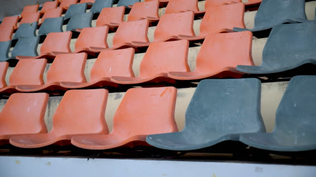row of blue and red stadium seats. - performing arts event stock videos & royalty-free footage