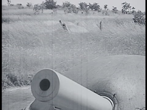 row of cannons rotating into position. int vs french soldier turning wheel. soldier loading artillery shell into barrel. ext cannon barrel rising.... - maginot linie stock-videos und b-roll-filmmaterial