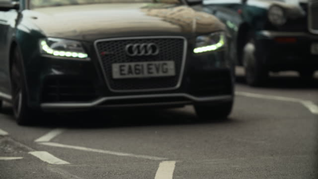 cu selective focus row of cars passing through / london, england, united kingdom - number plate stock videos & royalty-free footage
