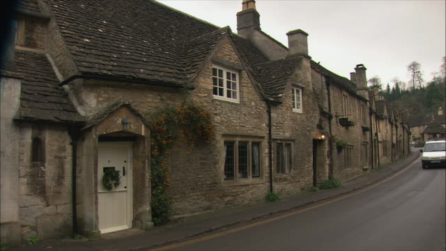 WS Row of cotswolds stone buildings in old village / United Kingdom