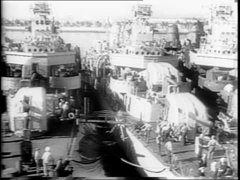 row of destroyer ships docked in san diego / panning shot of ships in port / closer view of ships / soldier pointing out japanese flags and hit... - plastic cap stock videos & royalty-free footage