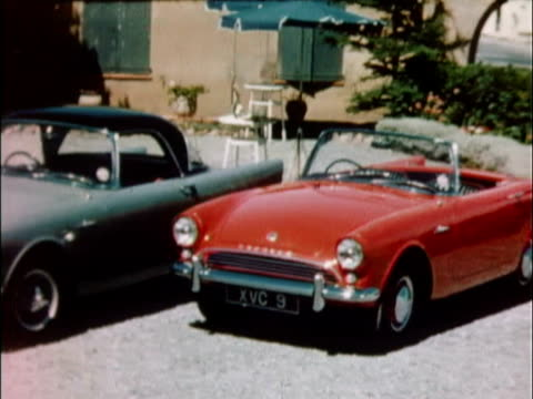 1959 ws pan row of diagonally parked 1959 sunbeam alpine cars, each different color / united kingdom - 1959 stock videos & royalty-free footage