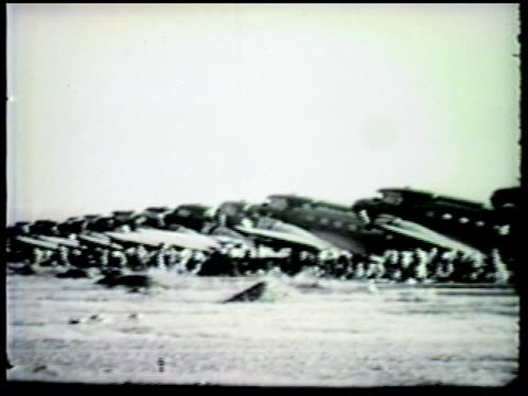 stockvideo's en b-roll-footage met row of douglas c47 skytrain on airbase at port moresby us south west pacific area commander general douglas macarthur overseeing us army 503rd... - douglas macarthur