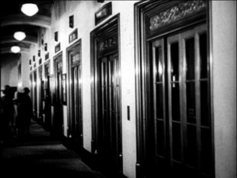 b/w 1924 row of elevators in building / newsreel - 1924 stock videos & royalty-free footage