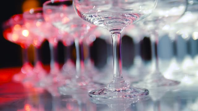 row of empty glass of champagne and wine - drinking glass stock videos & royalty-free footage