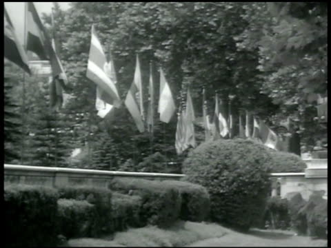 stockvideo's en b-roll-footage met diplomats row of flags canadian minister layton mccarthy w/ chinese minister of finance tv soong president of philippians manuel quezon owen dixon of... - 1942