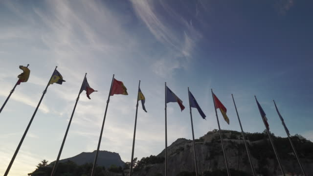 row of flags - grenoble, france - grenoble stock-videos und b-roll-filmmaterial