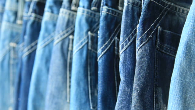 row of hanged blue jeans - jeans stock videos & royalty-free footage