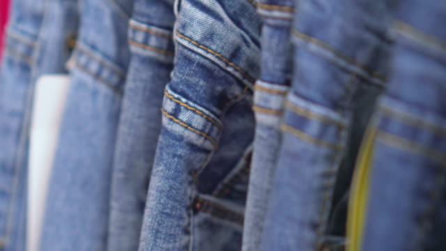 Row of hanged blue jeans,Dolly shot