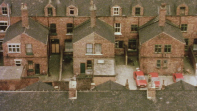 1981 montage row of homes in a tidy, middle-class suburb and residents socializing outside their homes / middlesbrough, england, united kingdom - middlesbrough stock videos and b-roll footage
