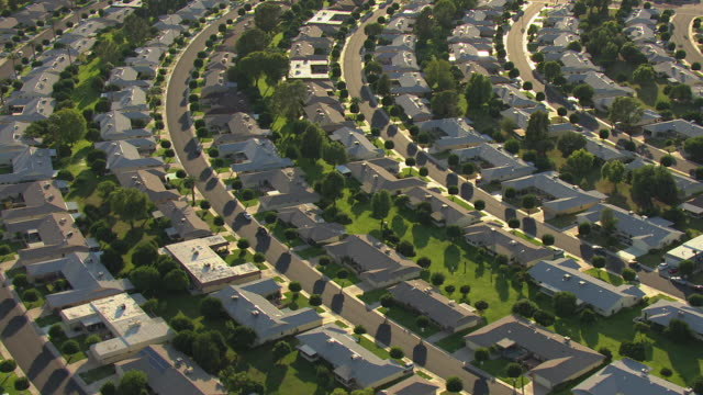 ms aerial ds row of houses with yards at sun city / phoenix, arizona, united states  - lawn stock videos & royalty-free footage