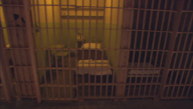ms ds row of identical prison cells at alcatraz / california, usa - jail cell stock videos & royalty-free footage