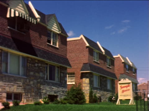 vidéos et rushes de 1959 pan row of identical suburban duplex houses / philadelphia, pa / documentary - 1950 1959