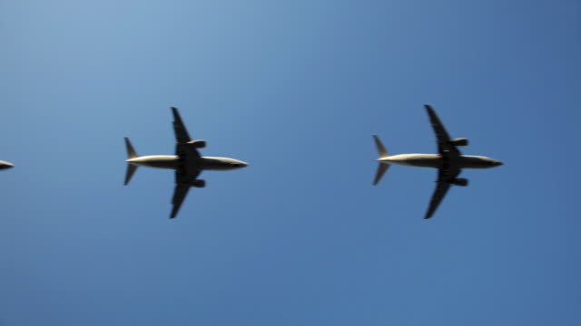 WS LA Row of jets flying against blue sky / Cologne, North Rhine Westphalia, Germany