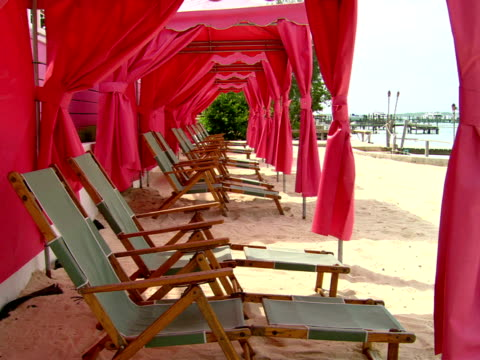 ms,  row of lounge chairs on beach,  harbour island,  bahamas - stationary process plate stock videos & royalty-free footage