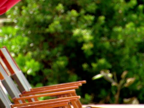 stockvideo's en b-roll-footage met zo,  row of lounge chairs on beach,  harbour island,  bahamas - kleine groep dingen
