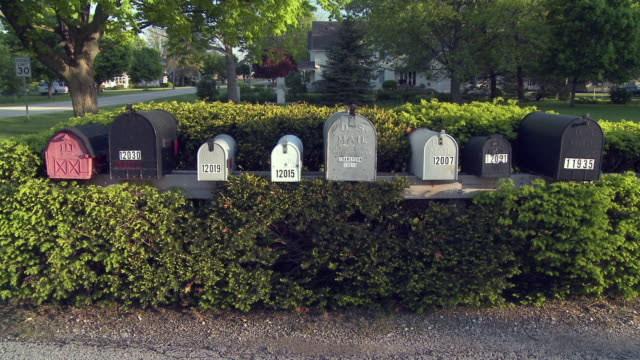 ms row of mailboxes on suburban street, newark, illinois, usa - letterbox stock videos & royalty-free footage