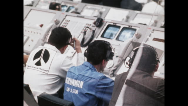 row of men working behind mission control panels at the jfk space center in florida for the launch of apollo 9. - control stock videos & royalty-free footage