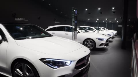 row of mercedes-benz cla sedans stands on display at the company's booth at the 2019 iaa frankfurt auto show on september 10, 2019 in frankfurt am... - mercedes benz markenname stock-videos und b-roll-filmmaterial