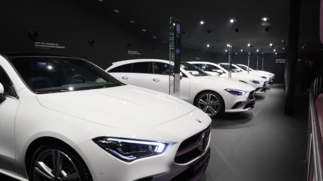 row of mercedes-benz cla sedans stands on display at the company's booth at the 2019 iaa frankfurt auto show on september 10, 2019 in frankfurt am... - ベンツ点の映像素材/bロール