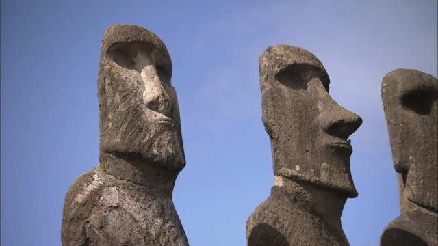 ms pan row of moai statues against clear sky / easter island, chile - maui stock videos & royalty-free footage