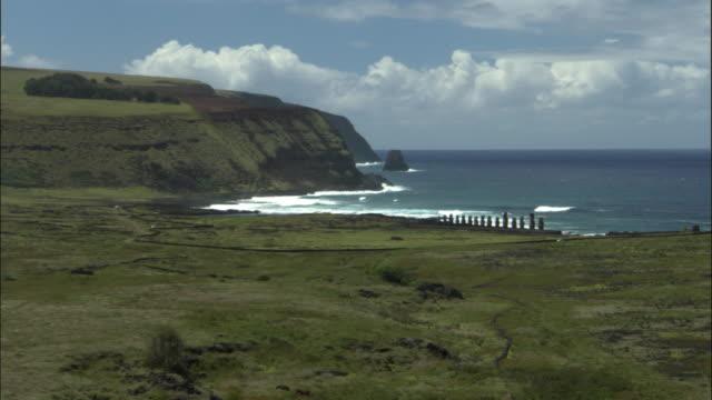 WS HA Row of Moai statues along coastline / Easter Island, Chile