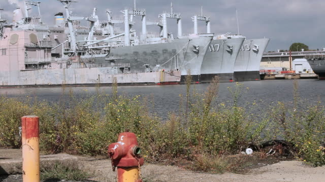 ms row of naval ships docked on waterway / philadelphia, pennsylvania, united states - 2000 2010 stil bildbanksvideor och videomaterial från bakom kulisserna