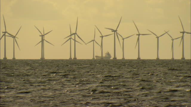 WS FOCUSING Row of offshore wind turbines turning in middle of sea / Malmo, Sweden