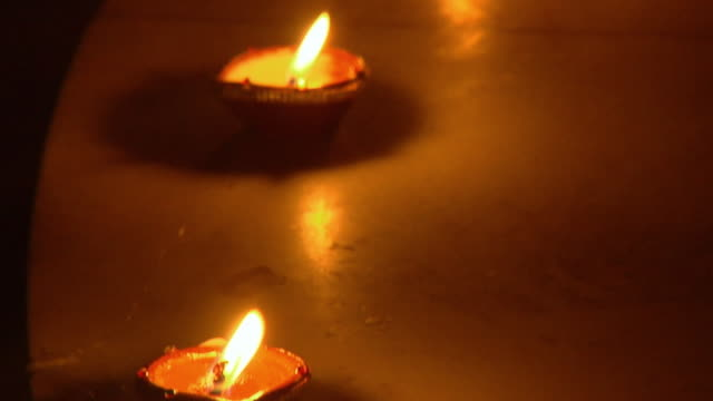 cu, td, row of oil lamps (diyas), chattarpur, new delhi, india - medium group of objects stock videos and b-roll footage