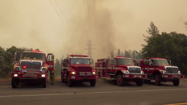 row of parked firetrucks in shasta county california on july 26, 2018. shasta county has been devastated by wildfires that have burned through... - fire engine stock videos & royalty-free footage