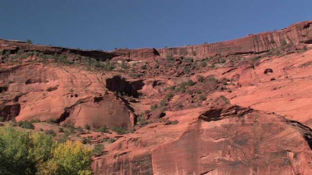 WS Row of people riding horses down rocky canyon slope/ Canyon de Chelly National Monument, Arizona