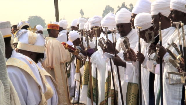 ms row of priests at procession of timka, ethiopian orthodox celebration of epiphany, addis ababa, ethiopia - äthiopien stock-videos und b-roll-filmmaterial
