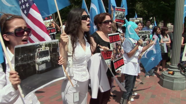 row of protestors shouting slogans and leader wearing barack obama 'hope' tshirt during an antichina protest outside the white house in support of... - hope stock videos & royalty-free footage