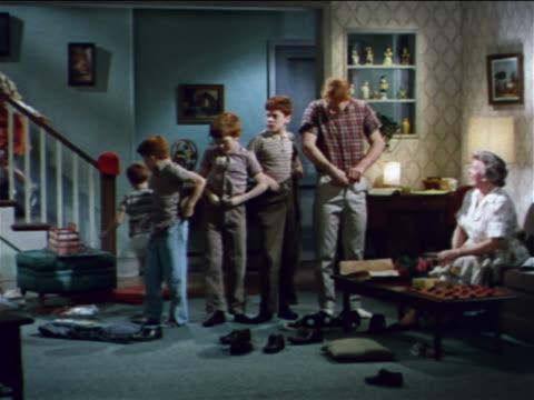 1962 row of redheaded boys buttoning pants + running up stairs / industrial - retrokläder bildbanksvideor och videomaterial från bakom kulisserna