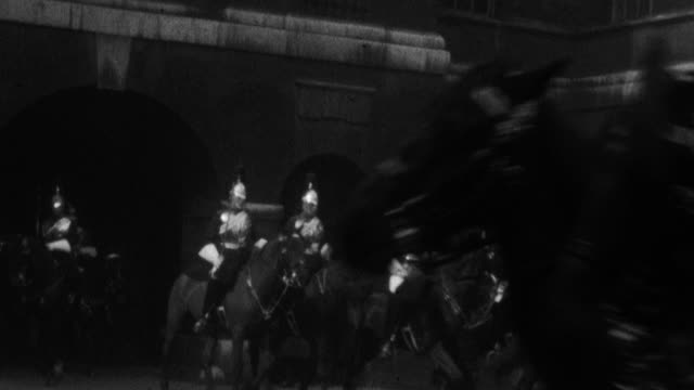 row of royal horse guards on horseback entering the royal horse guards grounds - 1925 stock videos & royalty-free footage