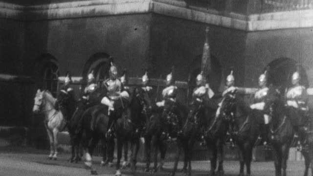 row of royal horse guards on horseback waiting on the royal horse guards grounds horse guard on white horse coming out from under an arch - 1925 stock videos & royalty-free footage