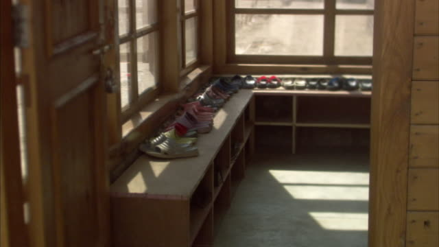 ws, row of shoes on bench, ladakh, jammu and kashmir, india - sandal stock videos and b-roll footage