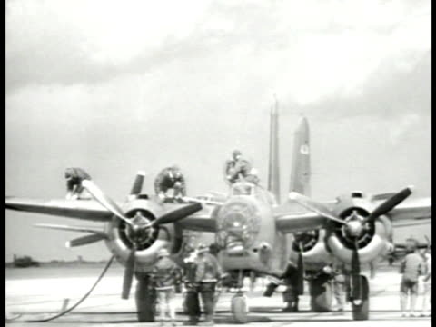 row of single engine fighter airplanes on field being serviced. servicing b-26 marauder bomber. m3 tanks lined up. military jeeps lined up. b-17... - air force stock videos & royalty-free footage