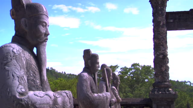 cu row of statues at khai dinh tomb, hue, vietnam - male likeness stock videos & royalty-free footage