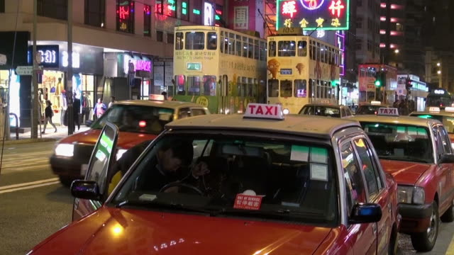 row of taxis in hong kong - one mid adult man only stock videos & royalty-free footage