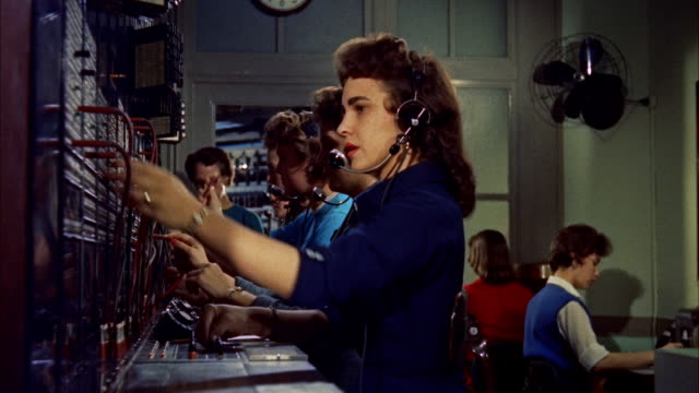 ms row of telephone operators at  switchboard / washington d.c. / united states - 電話交換機点の映像素材/bロール