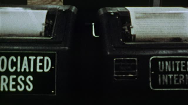 cu, pan, row of teleprinters in los angeles times newsroom, 1970's, los angeles, california, usa - プレスルーム点の映像素材/bロール
