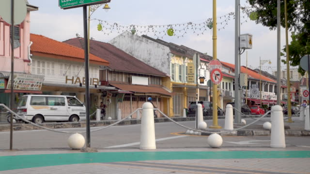 row of traditional retail shops along deserted street - malaysia stock videos & royalty-free footage