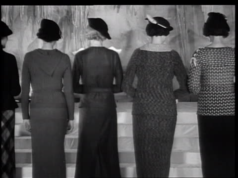 b/w 1934 rear view row of turning women modeling 1935 winter fashions / new york city - 1935 stock videos & royalty-free footage