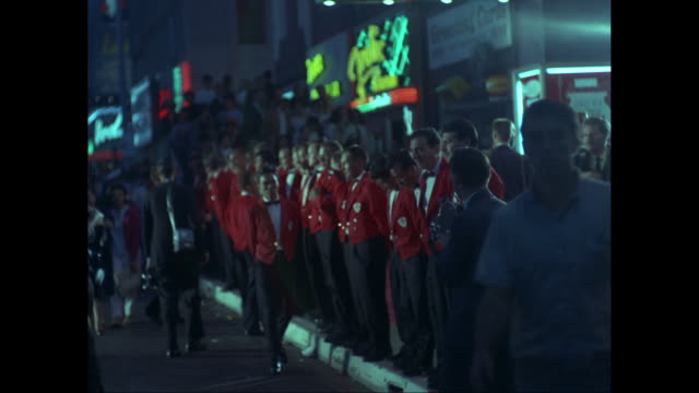 ws row of ushers in red jackets standing outside pantages theatre at night, traffic in foreground / los angeles, california, united states - pantages theater stock videos & royalty-free footage