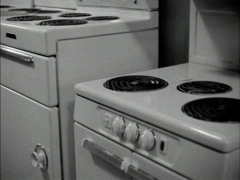 row of white cookers in a department store. 1958. - department store stock videos & royalty-free footage