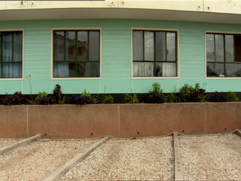 ws row of windows in front of united nations assistance mission building / kigali, rwanda  - davanti video stock e b–roll