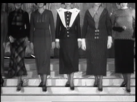 b/w 1934 row of women descending stairs toward camera modeling 1935 winter fashions / new york city - haute couture stock videos and b-roll footage